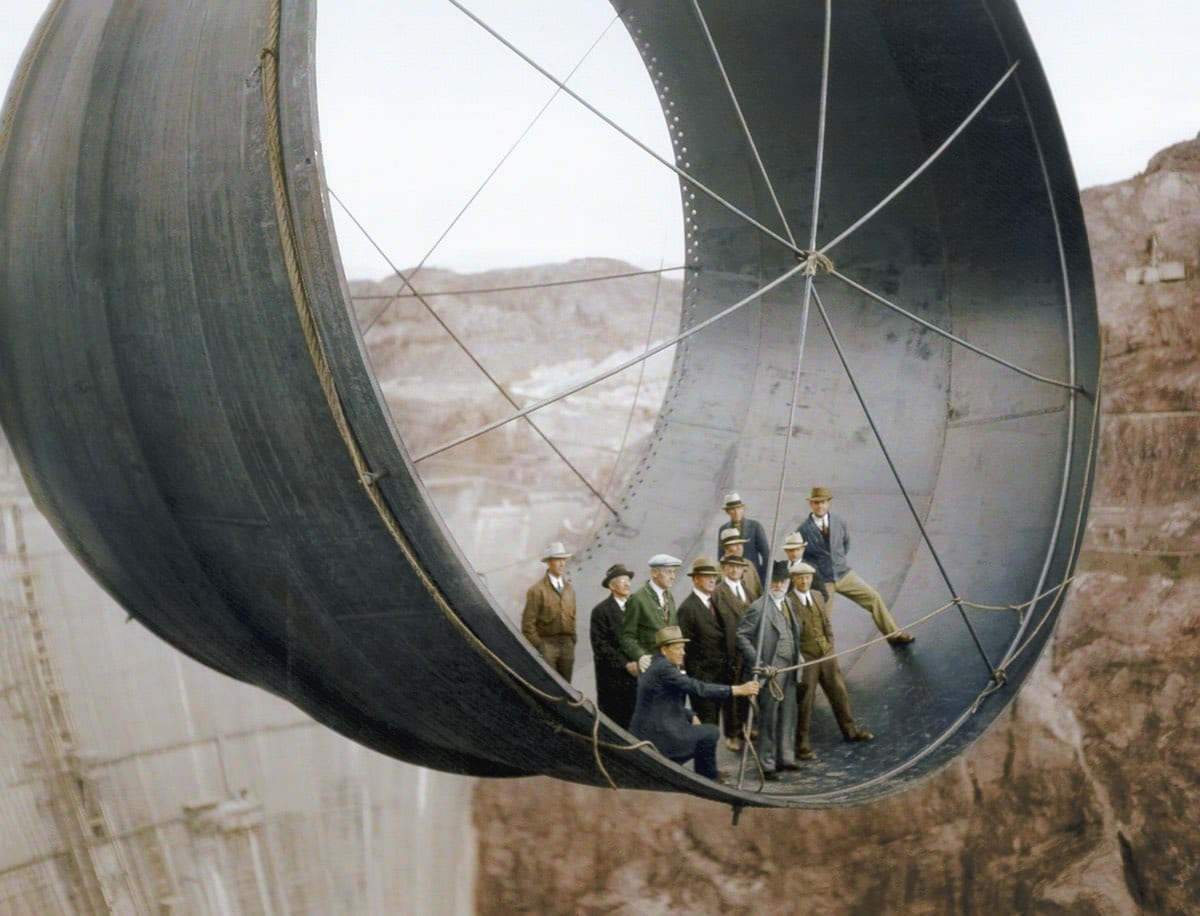 1935 - Officials in a pipe by the soon to be completed Hoover Dam, Arizona