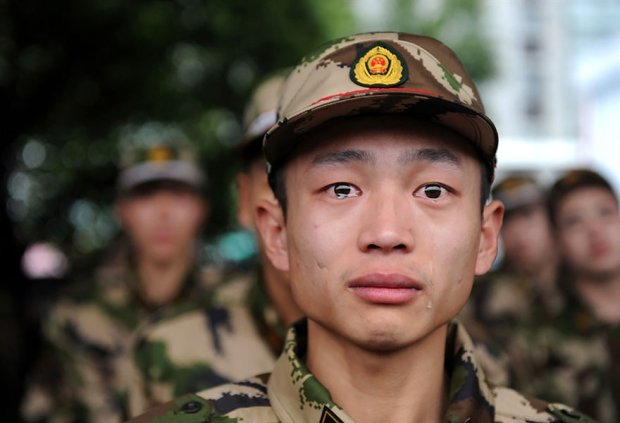 A Young Chinese Solider Breaks down into Tears before Shipping off for Service