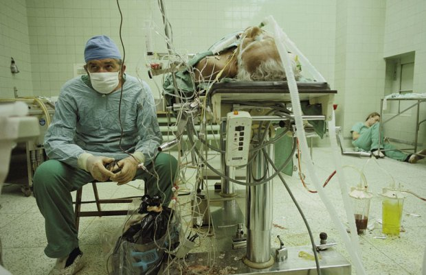 Famous Surgeon Zbigniew Religa Sits Exhausted after a 23-Hour Long Heart Transplant Procedure Which Was a Success