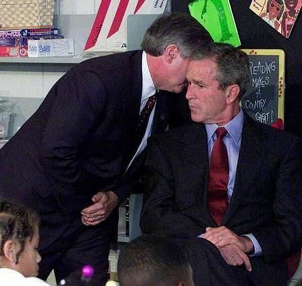 George Bush receiving a news on September 11, 2001